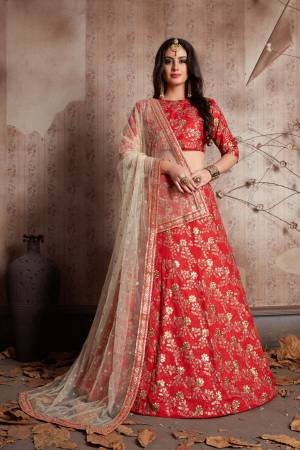 This set features a red sleeves blouse in raw silk base with floral gold zari & sequins embroidery all over. It is paired with matching gold embroidered red raw silk flared lehenga. It comes along with cream net dupatta with gold lace all over.