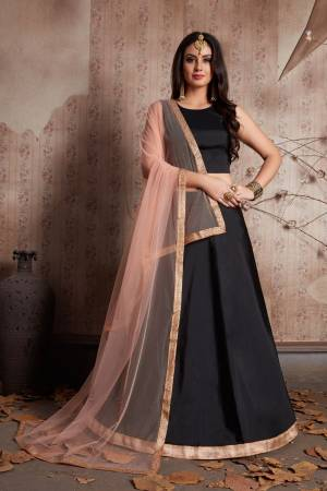 Featuring a jade black pure lavished in taffeta silk. It comes along with soft net dupatta cornered with lacework. Its tassels are in peach color giving an amazing twist to the blouse. Back of the blouse is normal U-Shaped.