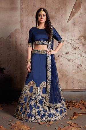 This set features a dark Navy blue art silk dori work lehenga choli set. It comes along with stone and dori lace work on dupatta and heavy embroidery work on lehenga. Matching blouse with short sleeves.