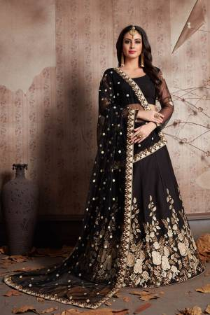 This set features designer black color heavily embellished lehenga choli. It is paired with matching black flared crepe base lehenga with matching crepe base blouse with soft net dupatta set.