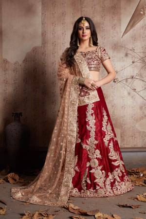 This set features a maroon semi velvet dori work lehenga choli set. It comes along with zari and dori lace work on dupatta and heavy embroidery butta on dupatta. Matching blouse with heavy dori work and zari work.