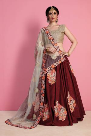 Maroon color leheng with multi color thread work is base on Art silk fabric with Cream color dupatta is base on net with have thread work lace on dupatta with embroidery worked blouse.