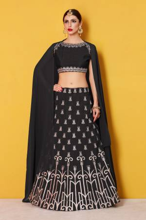 Featuring a Black blouse in art silk with silver gold embroidery and it comes along with black lehenga in art silk. It is paired with black plain dupatta in chanderi.