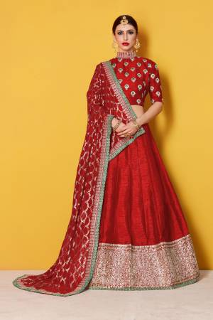 This set features a red art silk zari and sequins work bordered lehenga. It comes along with zari and dori lace  work on dupatta and heavy embroidery sequins work on dupatta. Matching blouse with heavy zari work butti.