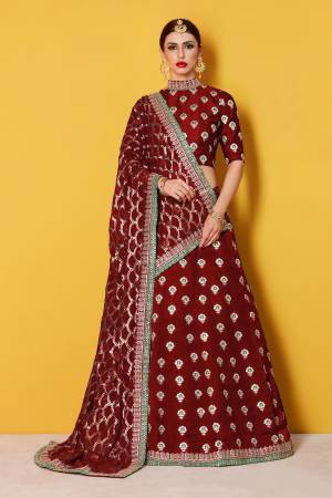 This set features a Maroon Art silk zari work lehenga choli set. It comes along with zari and dori lace  work on dupatta and heavy embroidery sequins work on dupatta. Matching blouse with heavy zari work butti.