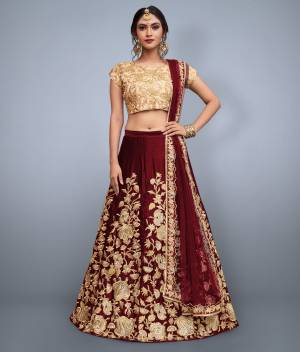 This set features maroon velvet dori work lehenga choli set. It comes along with cut work dupatta on net base. Matching Beige Colored blouse with heavy dori work.Looks completely heavy work.
