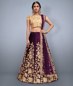 This set features purple velvet dori work lehenga choli set. It comes along with cut work dupatta on net base. Matching Beige Colored  blouse with heavy dori work.Looks completely heavy work.