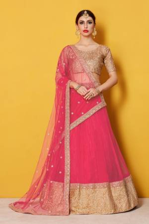 Featuring a scoop neck sequinned glitter blouse and a solid color net lehenga with a matching Pink shantoon interlining. The lehenga has a 9