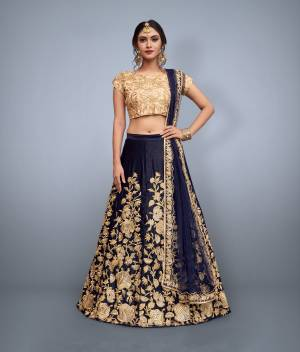 This set features a nay blue velvet dori work lehenga choli set. It comes along with cut work dupatta on net base. Matching blouse with heavy dori work. Looks completely heavy work.