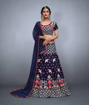 Glam up  look graceful on this wedding and festival occasion.The navy blue colored velvet choli and soft net dupatta with lavish resham embroidery and velvet flared resham, zari and mirror work embroidered lehenga.