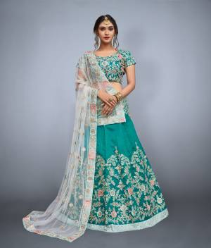 Featuring a Teal green blouse in art silk with dori work embroidery and it comes along with Teal green lehenga in art silk. It is paired with Off-White embroidered dupatta in net.