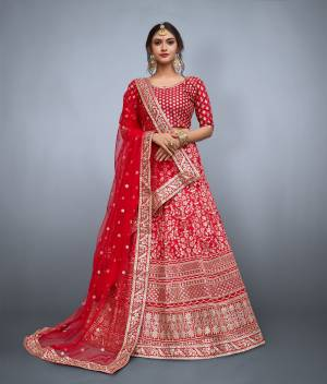 This set features red floral resham work with sequins embellished on it. It comes along with matching red blouse and sequins embellished on it. It is paired with soft net butti work in sequins and heavy lace work on it.