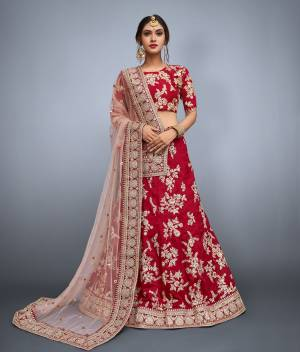 Featuring a round neck glitter sequin and dori work blouse and a Maroon color banglori silk lehenga with a matching Maroon shantoon interlining. The lehenga has a dori intricate design and matte glitter sequins work on it. Along with the set comes a matching beige shade on net dupatta embroidered with intricate sequins butis and heavy dori work lace cornered.