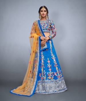 Celebrate your close one's wedding day by wearing this beautiful bridesmaids lehenga.Fashioned out of banglori silk fabric and colored in yale blue color this lehenga is embellished with resham,sequins,zari embroidery which will definitely make your heart melt. Enchant your surrounding by dressing up in this masterpiece which has been designed keeping in mind today's fashion. Available with yale blue color raw silk embroidered blouse peice and a chrome yellow color soft net dupatta.