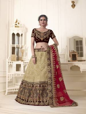 For a royal and unique look, grab this heavy designer lehenga choli which will earn you lots of compliments from onlookers. Its blouse is in brown color paired with beige colored lehenga and red colored dupatta. Its blouse is fabricated on velvet paired with art silk and velvet fabricated lehenga and net dupatta. Buy now.