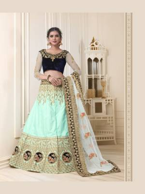 Here are beautiful shades of blue with this heavy designer lehenga choli in navy blue colored blouse paired with aqua blue colored lehenga and off-white colored dupatta. Its blouse is velvet based fabric paired with art silk lehenga and net dupatta. All Its fabrics esnures superb comfort all day long.