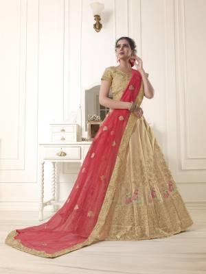 Flaunt your rich and elegant taste with this simple but heavy designer lehenga choli in beige color paired with red colored dupatta. Its blouse and lehenga are fabricated on art silk paired with net fabricated dupatta. Buy now.