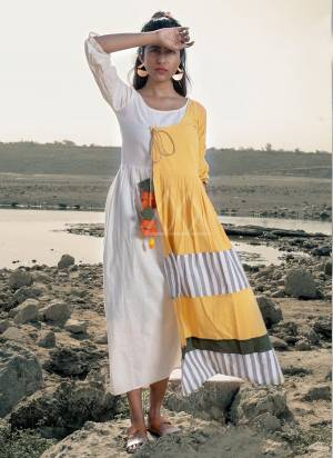 Grab This Beautiful linen long maxi casual dress has a flap over regular silhoutte.? The basic angarakha style is used for trendy look along with hangings and handmade pompoms. handmade with Love. khadi is a fabric that will keep you cool in summers and warm in winters.  so this dress suits to wear in all season?