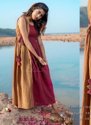 Grab This Beautiful Maxi Dress In Maroon and Beige Color In Sleeveless pattern with adjustable waist tie up and hanging laces are clubbed with hand-made pompom hangings.?khadi is a fabric that will keep you cool in summers and warm in winters