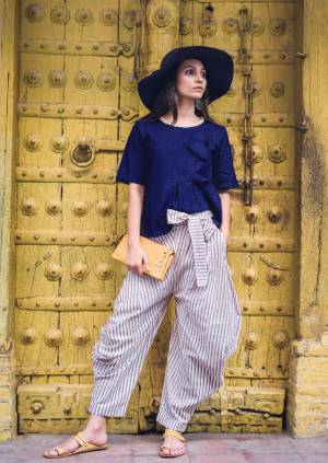 Cowl pant weaved in plain and ikat lining pattern, Ankle is sleek to give a slim look with Long length pockets on both sides, Has a back pocket also .Two flaps to tie knot at the waist, TOP - Royal Blue color fornt pleated crop top with edge round neck line . top has jute strings to tie at the back , sleeves reaches elbow
