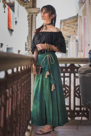 Trendy And Classy Are Two Perfect Word For Todays Generation, Grab This Beautiful Pair In Black Colored Off Shoulder Top Paired With Pine Green Colored Bottom .Both Are Khadi Cotton Based Fabric Available In Sizes.