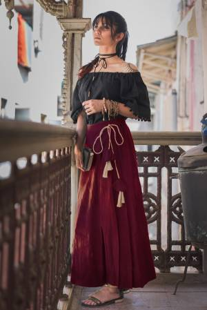 Trendy And Classy Are Two Perfect Word For Todays Generation, Grab This Beautiful Pair In Black Colored Off Shoulder Top Paired With Maroon Colored Bottom .Both Are Khadi Cotton Based Fabric Available In Sizes.