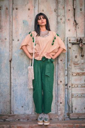 Be It Your College Wear Or For An Outing This Lovely Pair Of Top And Pants Is Suitable For All. Its Top Is In Beige Color Paired With Green Colored Bottom. This Khadi Cotton Based Dress Is Available In Sizes, Choose As Per Your Desired Comfort. Buy Now.