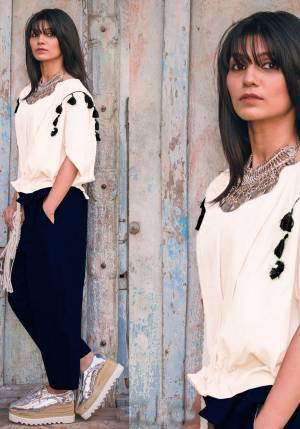 Be It Your College Wear Or For An Outing This Lovely Pair Of Top And Pants Is Suitable For All. Its Top Is In Off-white Color Paired With Navy Blue Colored Bottom. This Khadi Cotton Based Dress Is Available In Sizes, Choose As Per Your Desired Comfort. Buy Now.