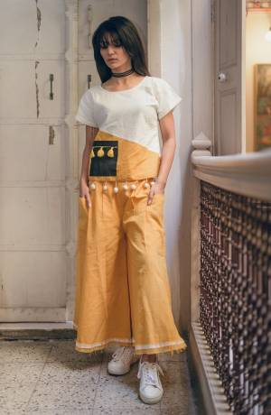 Pretty Simple Pair In Top And Pant Is Here With This White And Yellow Colored Top Paired With Yellow Colored Bottom. This Pair Is Khadi Cotton Based Which Is Suitable For All Season And Ensures Superb Comfort. Buy Now.