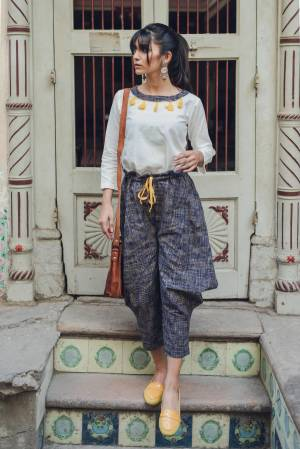Here Is A Lovely Baggy Pants Pair In White Colored Top Paired With Navy Blue Colored Baggy Pants. This Pair Is Khadi Cotton Based Fabric And Available In Sizes. Buy This Lovely Pair Now.
