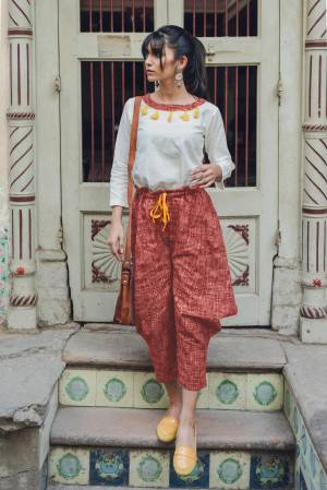 Here Is A Lovely Baggy Pants Pair In White Colored Top Paired With Rust Colored Baggy Pants. This Pair Is Khadi Cotton Based Fabric And Available In Sizes. Buy This Lovely Pair Now.