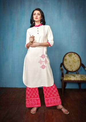 For Your Semi-Casual Wear Or Festive Wear, Grab This Readymade Kurti Set In White Colored Top Paired With Dark Pink Colored Bottom. Its Top Is Fabricated On Embroidered Rayon Paired With Printed Cotton Bottom.