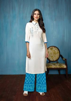 Elegant Looking Collar Pattern Readymade Kurta Set Is Here In White Colored Top Paired With Blue Colored Bottom. Its Top Is Rayon Fabricated Paired With Cotton Bottom. It Is Beautified with Thread Work And Prints Over The Bottom.