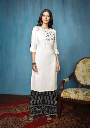 Rich and Elegant Looking Designer Readymade Kurta Set Is Here In White Colored Top Paired With black Colored Bottom. Its Top Is Rayon Based Fabric Paired With Cotton Bottom. Buy Now.