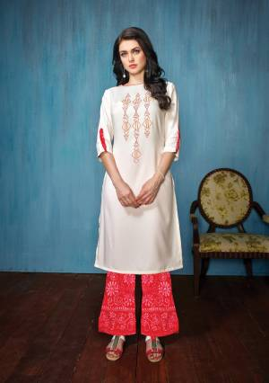 This Festive Season, Grab This pretty Kurta Set In White Colored Top Paired With Red Colored Bottom. Its Top Is Fabricated On Rayon Paired With Cotton Bottom. Both Its Fabrics Esnures Superb Comfort All Day Long.