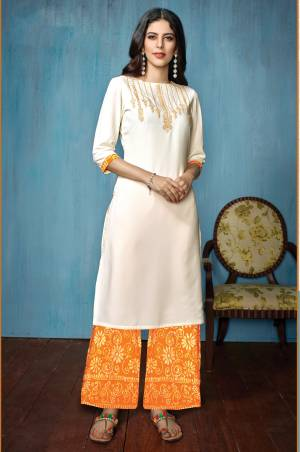 Look Beautiful And Earn Lots Of Compliments Wearing this Designer Readymade Kurta Set In White Colored Top Paired With Yellow Colored Bottom. Its Top Is Fabricated On Rayon Paired With Cotton Bottom. Buy Now.