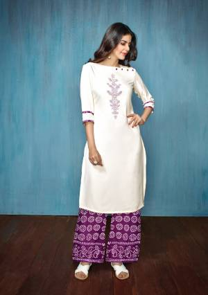 For Your Semi-Casual Wear Or Festive Wear, Grab This Readymade Kurti Set In White Colored Top Paired With Purple Colored Bottom. Its Top Is Fabricated On Embroidered Rayon Paired With Printed Cotton Bottom.