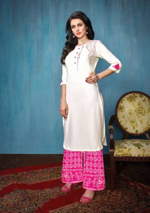 This Festive Season, Grab This pretty Kurta Set In White Colored Top Paired With Pink Colored Bottom. Its Top Is Fabricated On Rayon Paired With Cotton Bottom. Both Its Fabrics Esnures Superb Comfort All Day Long.