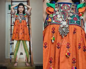 Kedias Are Not Only Meant For Boys, This Festive Season Grab This Beautiful And Attractive Set  Of Kedias With This Orange Colored Top Paired With Off-White Colored Bottom. Its Top And Bottom Are Khadi Based Fabric Beautiifed With Multi Colored Thread Work And Lace Border.