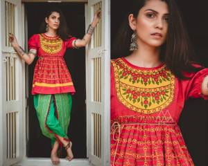 Grab This Trendy Looking Designer Kedia Set For Women In Red Colored Top Paired With Contrasting Green Colored Dhoti Bottom. This Top And Bottom Are Fabricated On Khadi Beautified With Thread Work And Lace Border.