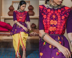 Add This Beauty To Your Wardrobe With This Designer Pair Of Kedias For This Festive Season. Its Top Is In Purple Color Paired With Contrasting Yellow Colored Dupatta. Its Top And Bottom Are Fabricated On Khadi Beautified With Thread Work And Lace Border.