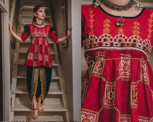 Grab This Trendy Looking Designer Kedia Set For Women In Red Colored Top Paired With Black Colored Dhoti Bottom. This Top And Bottom Are Fabricated On Khadi Beautified With Thread Work And Lace Border.