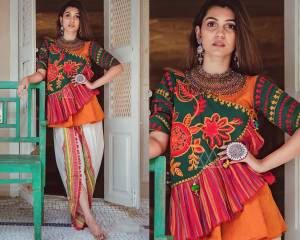 For A Proper Traditional Look With Traditional Colors, Grab This Designer Pair Of Kedias For Women In Orange And Green Colored Top Paired With Off-White Colored Dhoti. Its Top and Bottom are Khadi Based Fabric Beautified With Thread Work And Lace Border. Buy Now.