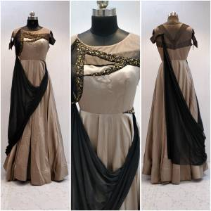Grab This Designer Readymade Gown For The Upcoming Occasion At Your Place With This Lovely Beige And Black Colored Gown Fabricated On Velevt Satin And Georgette Beautified with Hand Work. This Designer Lehenga Has Unique Drape Pattern Which Will Earn You Lots Of Compliments From Onlookers.