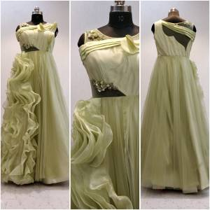 Add This Beautiful Designer Party Wear Readymade Gown To Your Wardrobe In Cream Color Fabricated Net. It Has Beautiful Frill Pattern Giving it A Designer And Attractive Look. Buy Now.
