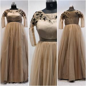 You Will Definitely Earn Lots Of Compliments Wearing This Designer Readymade Goewn To Your Wardrobe In Beige Color Fabricated On Net Beautified With Embroidery Over The Yoke With Attractive Pattern. Buy Now.