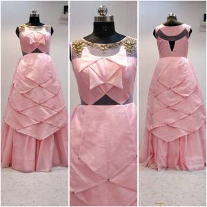 Look Very Pretty Wearing This Layered Pattern Designer Readymade Gown In Pink Color Fabricated On Oragenza. This Gown Has Attractive Pattern Work With Hand Work Over The Neckline, Buy Now.