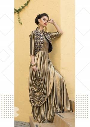 Look Attractive In This Golden Colored Readymade Gown Fabricated On Lycra. It Is Available In All Regular Sizes With Embroidered Jacket.