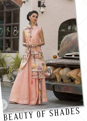 Look Pretty In This Designer Readymade Gown In Light Peach Color. This Gown Is Fabricated On Art Silk Beautified With Digital Prints All Over. Buy Now.