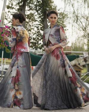 Flaunt Your Rich and Elegant Taste Wearing This Designer Gown In Dark Grey Color Fabricated On Art Silk . It Is Beautified With Digital Prints All Over.